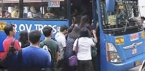 people riding a bus
