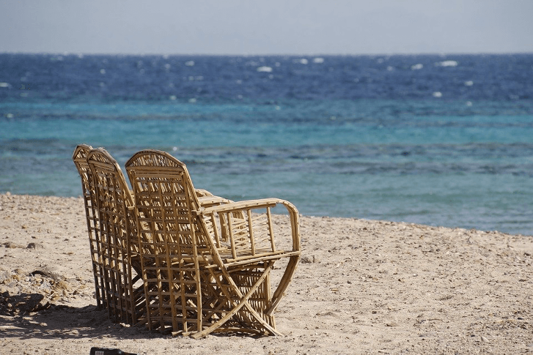Brace for the breeze while sitting on your airy rattan seat.